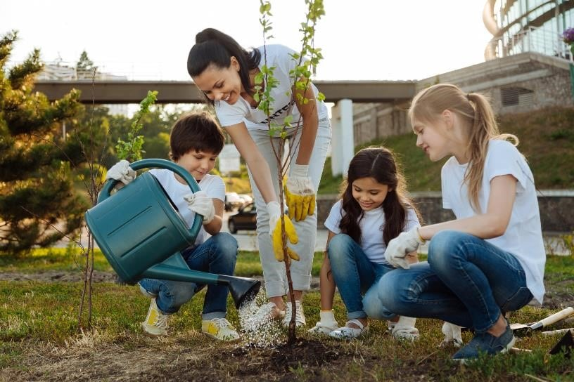 Family planting a tree together.